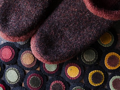 12-Knitted felted slippers and a wool penny rug