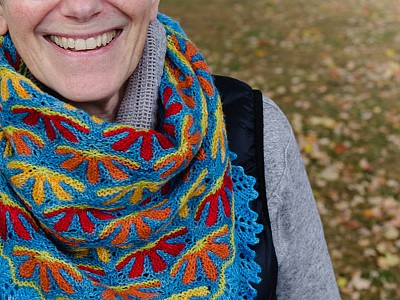 7-Mom models a knitted scarf created by her daughter